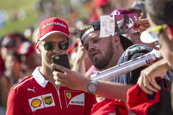 Sebastian Vettel (GER) Ferrari fans selfie at Formula One World Championship, Rd9, Austrian Grand Prix, Qualifying, Spielberg, Austria, Saturday 8 July 2017.