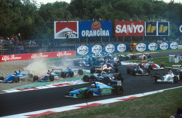1994 Italian Grand Prix.Monza, Italy.9-11 September 1994.Johnny Herbert (Lotus 109 Mugen-Honda) is spun round at the Rettifilo Chicane at the start by Eddie Irvine (Jordan 194 Hart) because he could not brake as quickly as him so ended up hitting him from behind. David Coulthard (Williams FW16B Renault) is caught by Herbert and spins whilst everybody else takes avoiding action in the melee.Ref-94 ITA 09.World Copyright - LAT Photographic