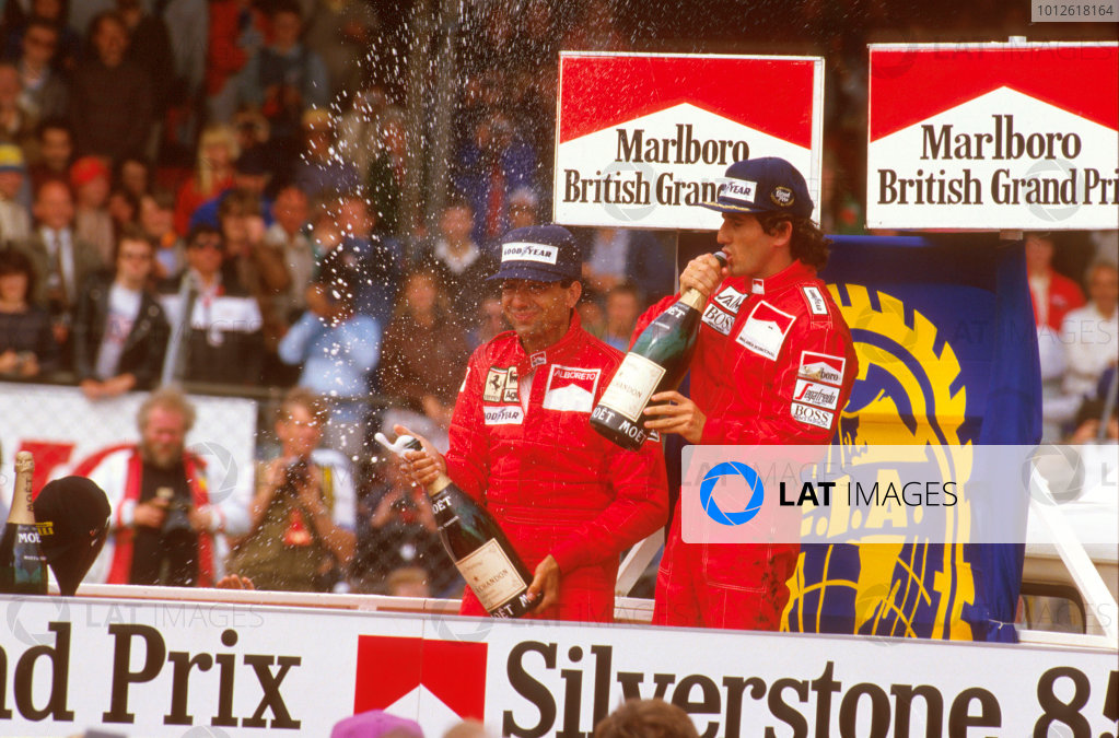 Silverstone, England.19-21 July 1985.Alain Prost (McLaren TAG Porsche) 1st position and Michele Alboreto (Ferrari) 2nd position on the podium.Ref-85 GB 08.World Copyright - LAT Photographic