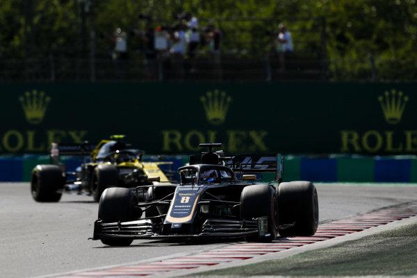Romain Grosjean, Haas VF-19, leads Nico Hulkenberg, Renault R.S. 19