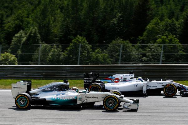 Red Bull Ring, Spielberg, Austria. Sunday 22 June 2014. Felipe Massa, Williams FW36 Mercedes, leads Lewis Hamilton, Mercedes F1 W05 Hybrid. World Copyright: Steven Tee/LAT Photographic. ref: Digital Image _L4R0392