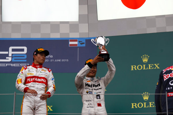 2015 GP2 Series Round 4. Red Bull Ring, Spielberg, Austria. Sunday 21 June 2015. Nobuharu Matsushita (JPN, ART Grand Prix) & Rio Haryanto (INA, Campos Racing)  Photo:  Sam Bloxham/GP2 Media Service ref: Digital Image _G7C6533