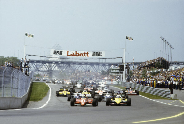 1983 Canadian Grand Prix  Montreal, Canada. 10-12th June 1983.  Rene Arnoux, Ferrari 126C2B, 1st position, and Alain Prost, Renault RE40, lead the field at the start.  Ref: 83CAN30. World copyright: LAT Photographic