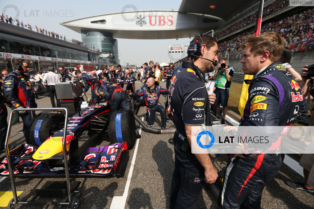 Shanghai International Circuit, Shanghai, China Sunday 14th April 2013 Sebastian Vettel, Red Bull Racing, on the grid. World Copyright: Andy Hone/LAT Photographic ref: Digital Image HONZ6601