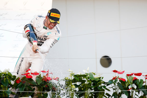 Suzuka Circuit, Suzuka, Japan. Sunday 27 September 2015. Lewis Hamilton, Mercedes AMG, 1st Position, sprays Champagne on the podium. World Copyright: Alastair Staley/LAT Photographic. ref: Digital Image _R6T2539