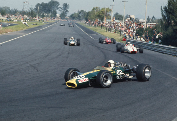 1967 Mexican Grand Prix. Mexico City, Mexico. 20-22 October 1967. Moises Solano (Lotus 49 Ford) leads John Surtees (Honda RA300), Denny Hulme (Brabham BT24 Repco) and Bruce McLaren (McLaren M5A BRM). Hulme finished in 3rd position. Ref-67 MEX 01 World Copyright - LAT Photographic