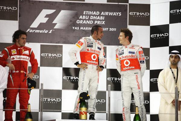 The podium (L to R): Fernando Alonso (ESP) Ferrari, second; Lewis Hamilton (GBR) McLaren, race winner; Jenson Button (GBR) McLaren, third. Formula One World Championship, Rd 18, Abu Dhabi Grand Prix, Race, Yas Marina Circuit, Abu Dhabi, UAE, Sunday 13 November 2011.