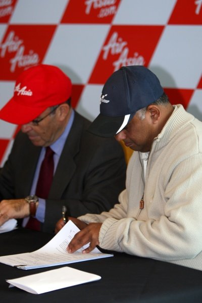 L-R: Carmelo Ezpeleta (ESP) CEO Dorna Sports S.L. and Tony Fernandes (MAL), CEO AirAsia Group, sign contracts.AirAsia Signs As Title Sponsor for 2010 MotoGP British Grand Prix, Silverstone, England, Wednesday 10 February 2010.