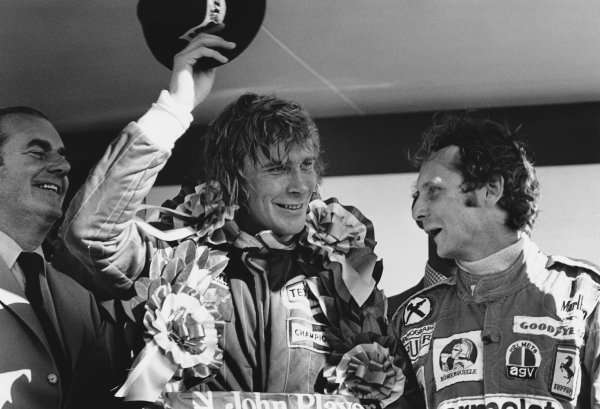 Brands Hatch, England. 16th - 18th July 1976.  James Hunt (McLaren M23 Ford), Disqualified and Niki Lauda (Ferrari 312T2), 1st position celebrate on the podium, portrait.  World Copyright: LAT Photographic.  Ref: 8877 - 23.