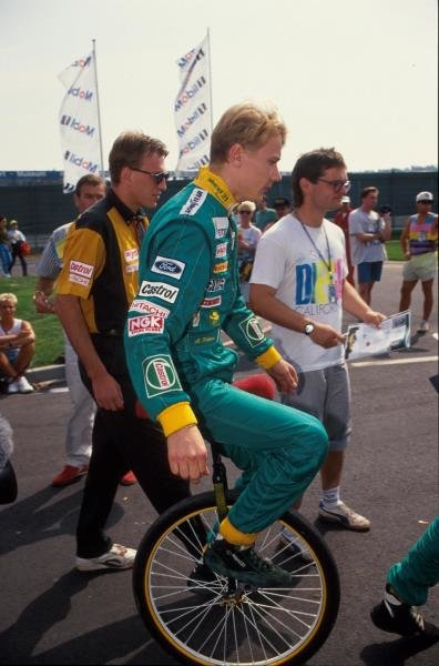 Mika Hakkinen (FIN) demonstrates admirable circus skills on his unicycle.   German Grand Prix, Hockenheim, 26 July 1992.