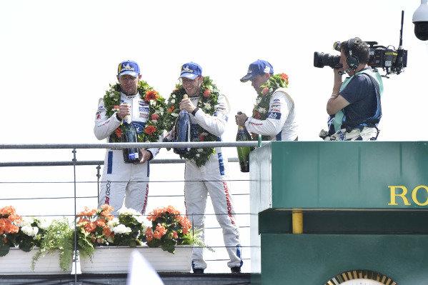 #68 Ford Chip Ganassi Racing Ford GT: Joey Hand, Dirk Müller, Sébastien Bourdais celebrate on the podium