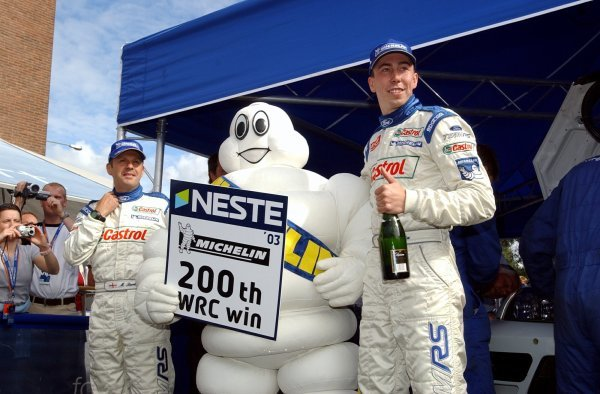 Michelin celebrate their 200th WRC win with Neste Rally Finland winners Markko Martin (EST), right, and co-driver Michael Park (GBR), left, Ford. FIA World Rally Championship, Rd9, Neste Rally Finland, Jyvaskyla, Finland, Day 3, 10 August 2003. DIGITAL IMAGE