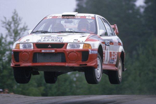 1998 World Rally Championship.1000 Lakes Rally, Finland. 21-23 August 1998.Tommi Makinen/Risto Mannisenmaki (Mitsubishi Lancer Evo5), 1st position.World Copyright: LAT PhotographicRef: 35mm transparency 98RALLY08