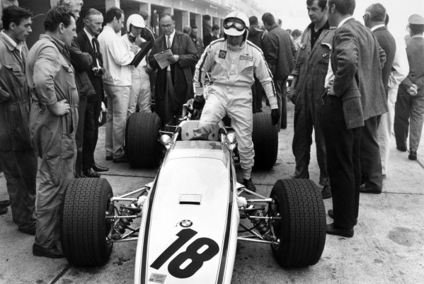 1968 German Grand Prix.Nurburgring, Germany. 4 August 1968.John Surtees climbs into the car of Hubert Hahne, Lola T100-BMW, 10th position, action.World Copyright: LAT PhotographicRef: L68/763 #3A