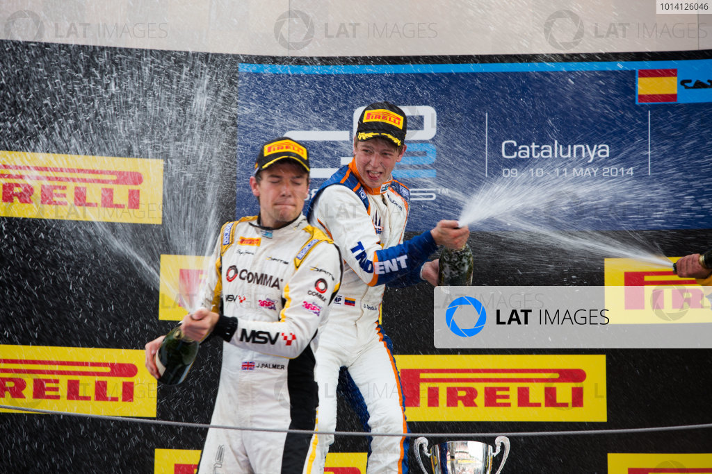 2014 GP2 Series Round 2 - Race 1. Circuit de Catalunya, Barcelona, Spain. Saturday 10 May 2014. Johnny Cecotto (VEN, Trident) & Jolyon Palmer (GBR, DAMS) spray champagne Photo: Malcolm Griffiths/GP2 Series Media Service. ref: Digital Image A50A3187