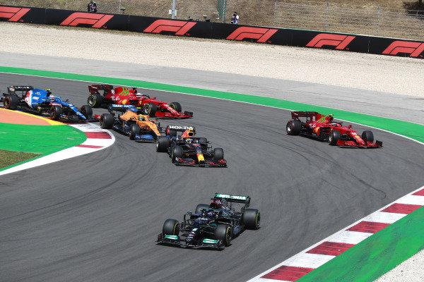 Sir Lewis Hamilton, Mercedes W12, leads Sergio Perez, Red Bull Racing RB16B, Carlos Sainz, Ferrari SF21, Lando Norris, McLaren MCL35M, Charles Leclerc, Ferrari SF21, and Esteban Ocon, Alpine A521