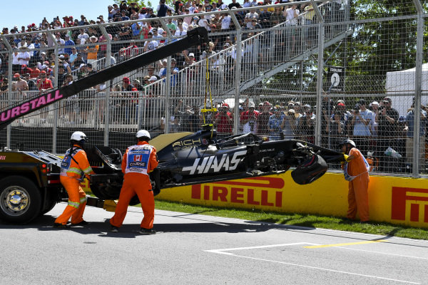 Car of Kevin Magnussen, Haas VF-19 is recovered after crashing in qualifying