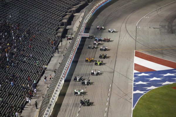 Josef Newgarden, Team Penske Chevrolet leads the final restart as Graham Rahal, Rahal Letterman Lanigan Racing Honda and Simon Pagenaud, Team Penske Chevrolet make contact