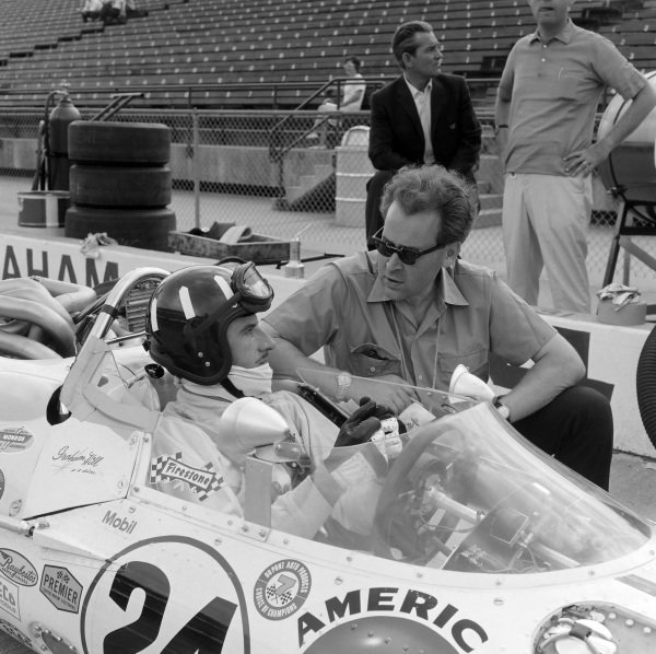 Graham Hill, John Mecom, Lola T90 Ford, in the pits with Eric Broadley, founder and chief designer of Lola Cars.