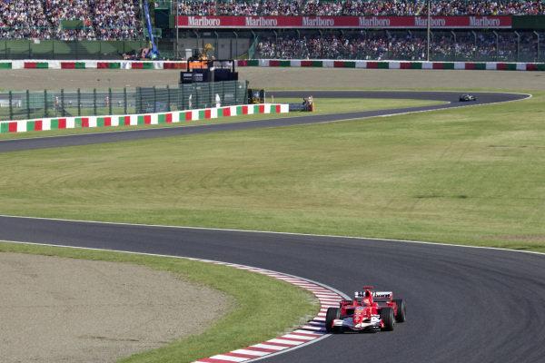 Michael Schumacher, Ferrari 248 F1 leads Fernando Alonso, Renault R26.