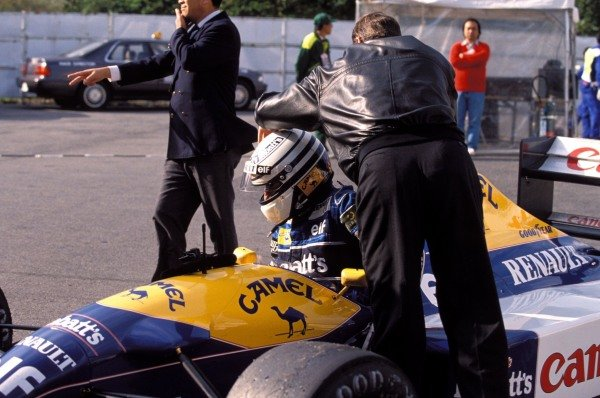 Riccardo Patrese climbs out of his Williams FW14B Renault.