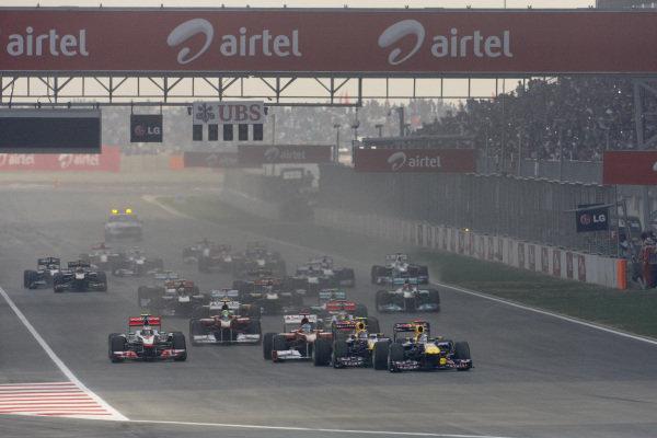 Sebastian Vettel, Red Bull RB7 Renault, leads Mark Webber, Red Bull RB7 Renault, Fernando Alonso, Ferrari 150° Italia, and Jenson Button, McLaren MP4-26 Mercedes, at the start.