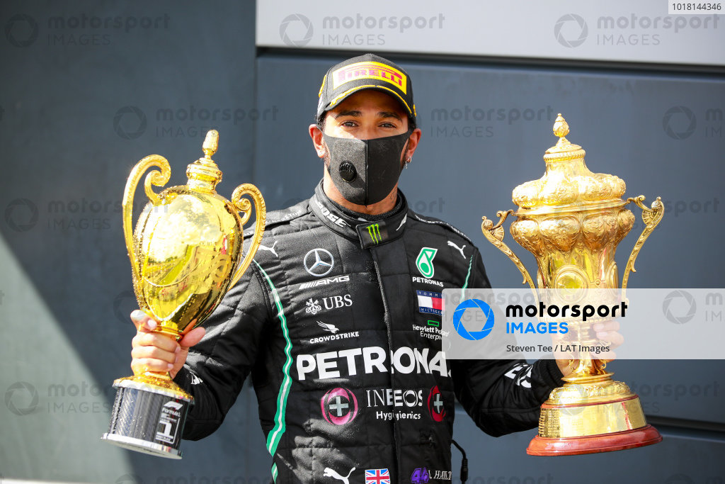 Race Winner Lewis Hamilton, Mercedes-AMG Petronas F1 with the trophies on the podium