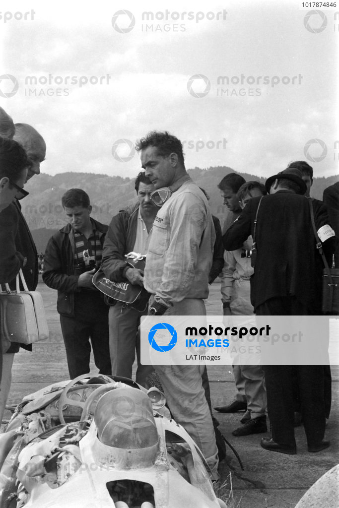 Phil Hill, Cooper T66 Climax, inspects his burned out car.