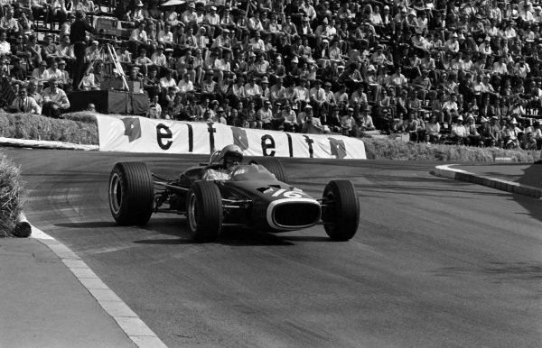 Bruce McLaren, McLaren M4B BRM, gets sideways on the exit of the Station Hairpin.