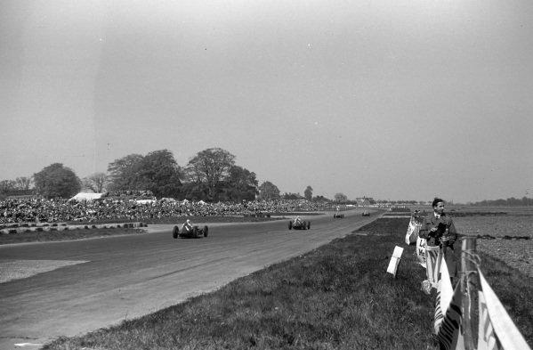 Giuseppe Farina, Alfa Romeo 158, leads Luigi Fagioli, Alfa Romeo 158, Juan Manuel Fangio, Alfa Romeo 158, and Reg Parnell, Alfa Romeo 158.