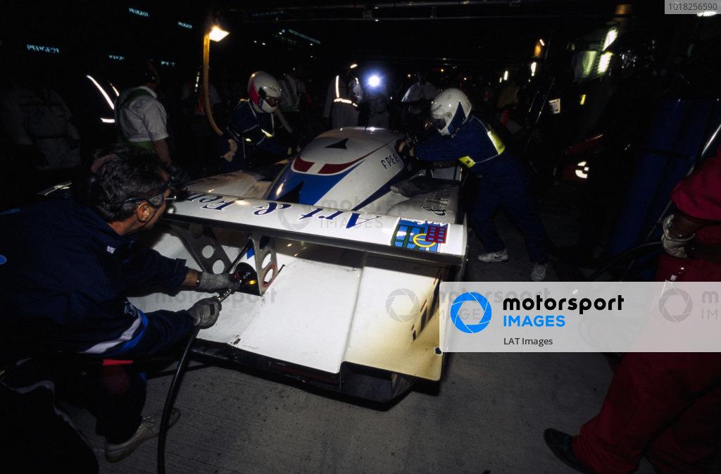 Lionel Robert / Pascal Fabre / Pierre-Henri Raphanel, Courage Compètition, Courage C32LM - Porsche 935/82, makes a pit stop at night.