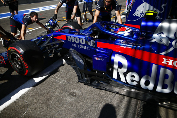 Pierre Gasly, Toro Rosso STR14, is returned to the garage