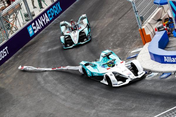 Tom Dillmann (FRA), NIO Formula E Team, NIO Sport 004, with an advertising banner stuck to his car, leads Mitch Evans (NZL), Panasonic Jaguar Racing, Jaguar I-Type 3