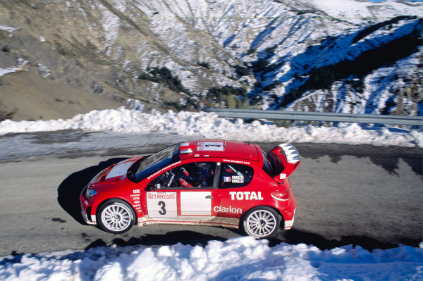 2003 FIA World Rally Championship. Monte Carlo, Monaco. Rd1.23-26 January 2003.Gilles Panizzi/Herve Panizzi (Peugeot 206 WRC).World Copyright: McKlein/LAT Photographicref: 35mm Image A39