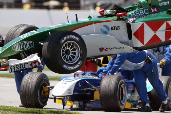 2004 United States Grand Prix - Sunday Race,2004 United States Grand PrixIndianapolis, USA. 20th June 2004 Christian Klien's Jaguar R5 is lifted away as marshalls push Felipe Massa's Sauber Petronas C23 in their efforts to clear up the first corner accident. World Copyright: Steve Etherington/LAT Photographic ref: Digital Image Only