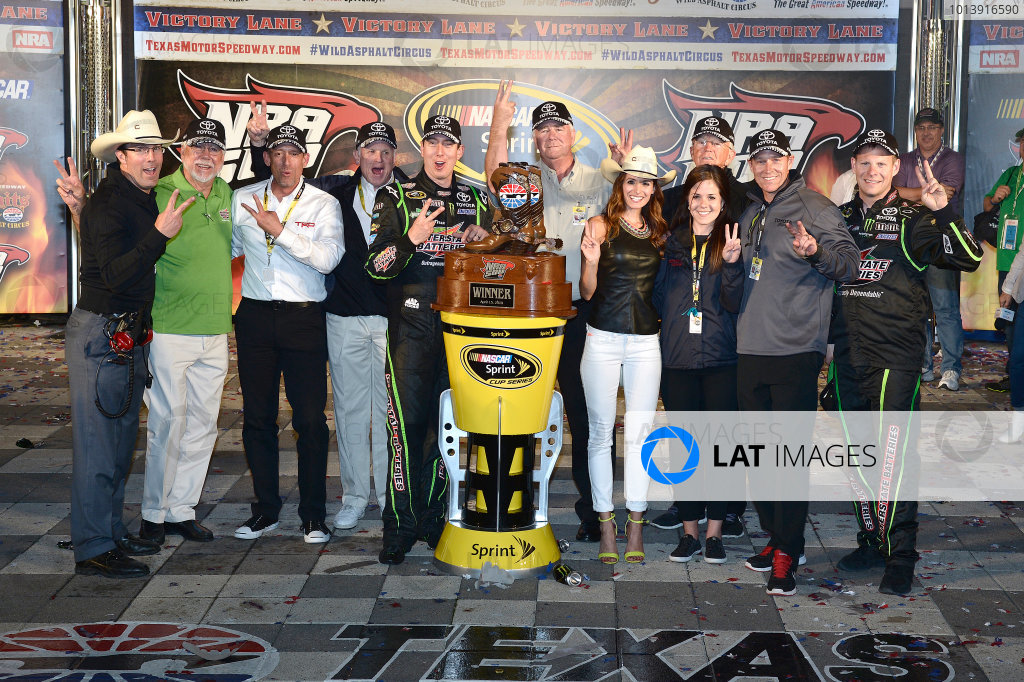 11-12 April, 2013, Fort Worth, Texas, USA Winner Kyle Busch in Victory Lane with team and Toyota personnel © 2013, Brian Czobat LAT Photo USA.