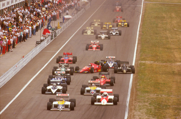 Hockenheim, Germany.25-27 July 1986.Stefan Johansson (Ferrari F186) gets completely crossed up after tripping over Alliot's Ligier at the start. He is just about to hit Fabi's Benetton. Ref-86 GER 08.World Copyright - LAT Photographic