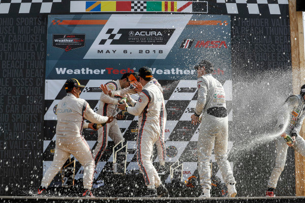 #7 Acura Team Penske Acura DPi, P: Helio Castroneves, Ricky Taylor, podium, #6 Acura Team Penske Acura DPi, P: Dane Cameron, Juan Pablo Montoya, #77 Mazda Team Joest Mazda DPi, P: Oliver Jarvis, Tristan Nunez, champagne