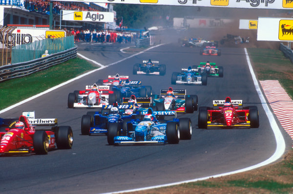 Estoril, Portugal.22-24 September 1995.As most of the field enters the first corner, in the background Ukyo Katayama's Tyrrell 023 Yamaha goes through a number of horrifying somersaults after interlocking wheels with Luca Badoer at the start.Ref-95 POR 09.World Copyright - LAT Photographic