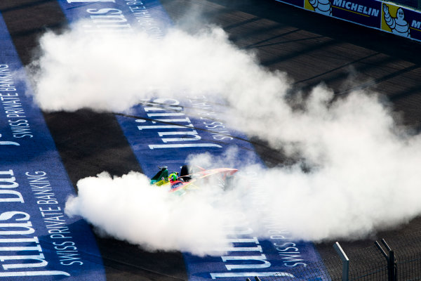 2015/2016 FIA Formula E Championship. Mexico City ePrix, Autodromo Hermanos Rodriguez, Mexico City, Mexico. Saturday 12 March 2016. Lucas Di Grassi (BRA), ABT Audi Sport FE01, celebrates winning the race by completing donuts. Photo: Zak Mauger/LAT/Formula E ref: Digital Image _79P3782