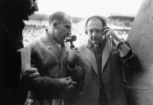 Le Mans, France. 28th - 29th July 1956.Stirling Moss (Aston Martin DB3S), 2nd position, talks on the radio in the pits, portrait. World Copyright: LAT Photographic.Ref:  7114J - 21.