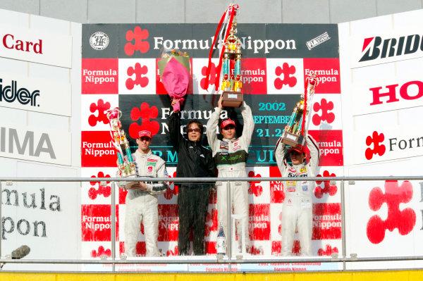 2002 Formula Nippon ChampionshipMine, Japan. 22nd September 2002.Race podium Satoshi Motoyama (XBOX Impul), 1st, Ralph Firman (PIAA Nakajima), 2nd and Ryo Michigami (5Zigen) 3rd.World Copyright: Yasushi Ishihara/LAT Photographicref: Digital Image Only