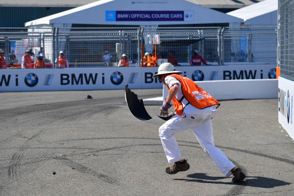 Marshal picks up the debris from track