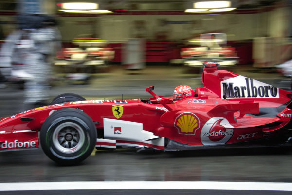 Michael Schumacher, Ferrari 248 F1 passing through the pitlane.