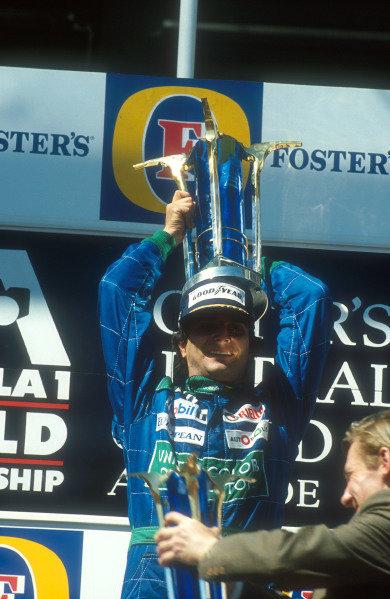 1990 Australian Grand Prix.Adelaide, Australia.2-4 November 1990.Nelson Piquet (Benetton Ford) celebrates 1st position on the podium.Ref-90 AUS 03.World Copyright - LAT Photographic