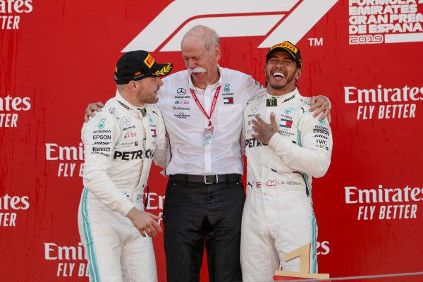 Valtteri Bottas, Mercedes AMG F1, Dr Dieter Zetsche, CEO, Mercedes Benz and Race winner Lewis Hamilton, Mercedes AMG F1 celebrate on the podium