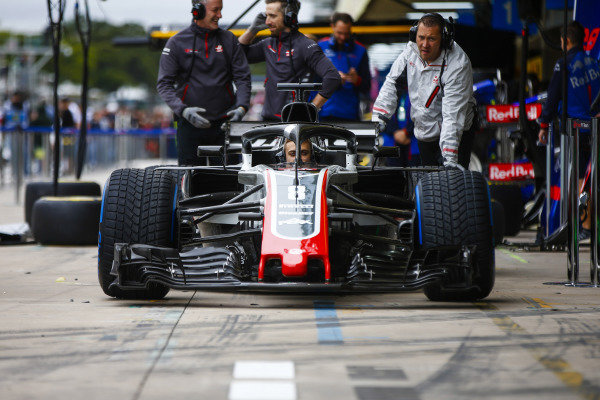 The Haas team conduct a practice pit stop with Formula 2 racer and development driver Louis Deletraz at the wheel.