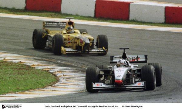1998 Brazilian Grand Prix.Interlagos, Sao Paulo, Brazil.27-29 March 1998.David Coulthard (McLaren MP4/13 Mercedes-Benz) leads Damon Hill (Jordan 198 Mugen Honda).World Copyright - Steve Etherington/LAT Photographic