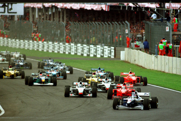 1997 British Grand Prix. Silverstone, England. 11-13 July 1997. Jacques Villeneuve (Williams FW19 Renault) leads at the start. He finished in 1st position. World Copyright - LAT Photographic