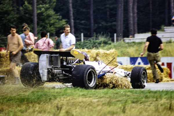 Jackie Oliver, BRM P153, scatters spectators after hitting hay bales.